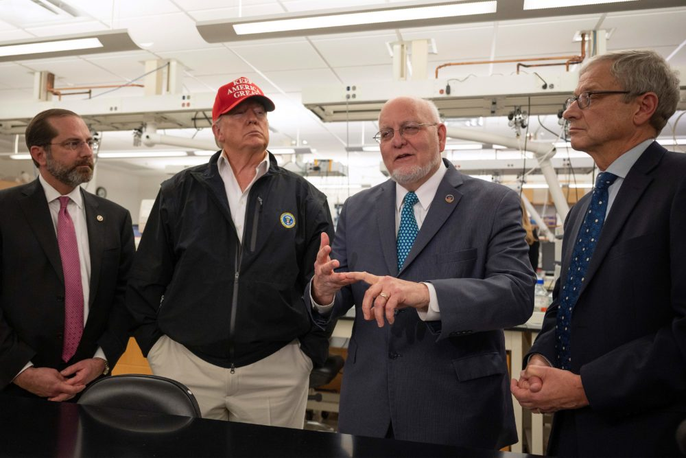 President Donald Trump (2nd L) stands next to US Health and Human Service Secretary Alex Azar (L), CDC Director Robert Redfield (2nd R), and CDC Associate Director for Laboratory Science and Safety (ADLSS) Dr. Steve Monroe during a tour of the Centers for Disease Control and Prevention (CDC) in Atlanta, Georgia, on March 6, 2020. (JIM WATSON/AFP via Getty Images)