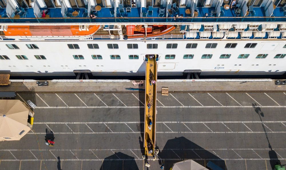 Passengers are disembarked from the Grand Princess cruise ship at the Port of Oakland in Oakland, California on March 10, 2020. (JOSH EDELSON/AFP via Getty Images)