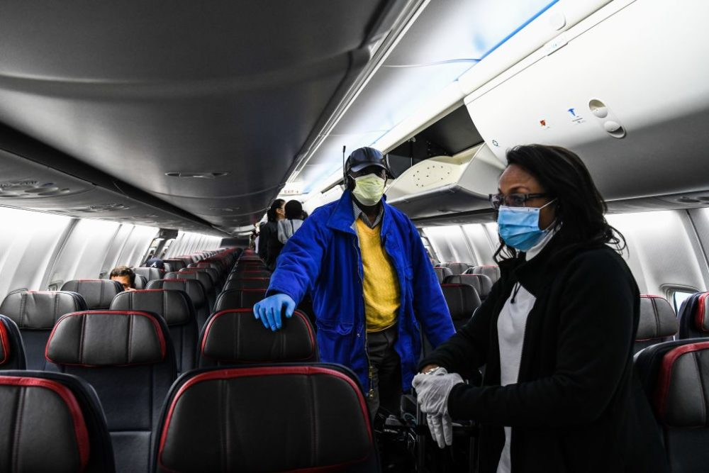 Passengers wait to disembark the plane on their arrival at Hartsfield-Jackson Atlanta International Airport in Atlanta, on April 23, 2020. (Chandan Khanna/AFP/Getty Images)