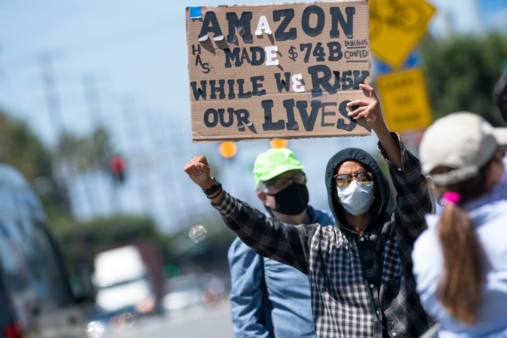 Workers protest the failure of their employers to provide adequate protections in the workplace of the Amazon delivery hub on National May Day Walkout/Sickout  amid the Covid-19 pandemic on May 1, 2020, in Hawthorne, California. (VALERIE MACON/AFP via Getty Images)