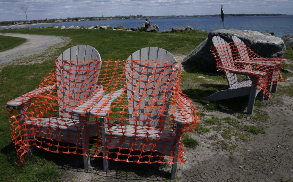 Adirondack chairs are covered in protective mesh on Tod's Point in Old Greenwich, Connecticut, on May 7, 2020. (Timothy A. Clary/AFP/Getty Images)