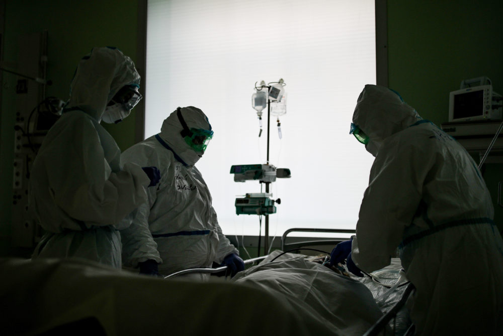 Employees at an intensive care unit of the Federal Clinical Center of Higher Medical Technologies of the Russian Federal Medical Biological Agency  treats COVID-19 patients, patients with suspected coronavirus and patients with viral community-acquired pneumonia. (PSergei Bobylev/Getty Images)
