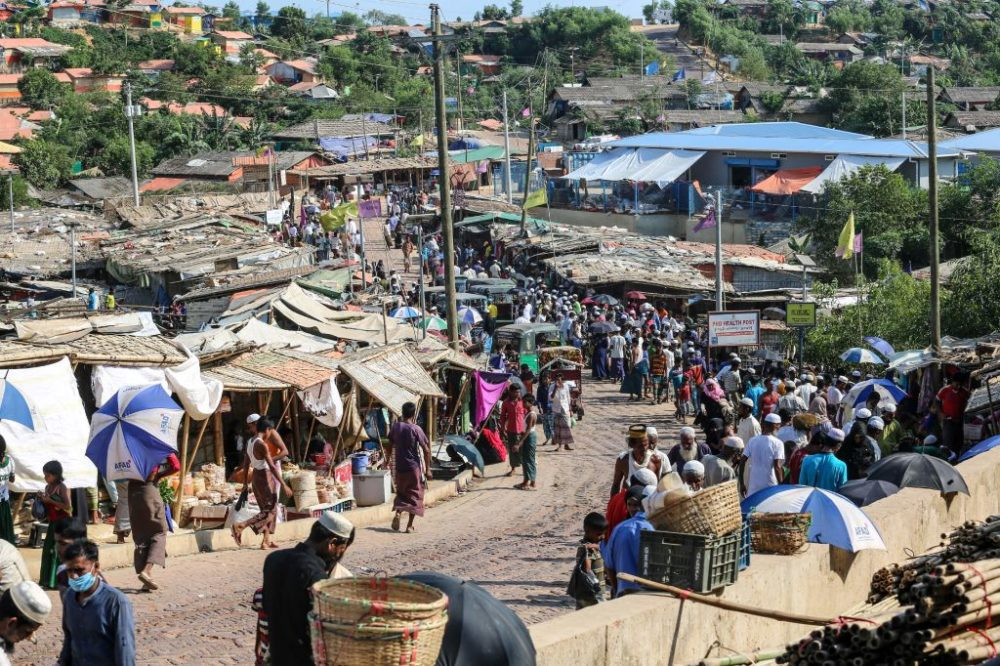 Rohingya refugees gather at a market as first cases of COVID-19 coronavirus have emerged in the area, in Kutupalong refugee camp in Ukhia on May 15, 2020. (Suzauddin Rubel/AFP/Getty Images)