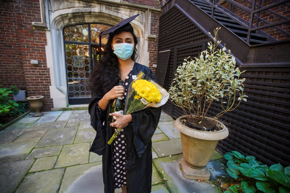 Pakistani student Varsha Thebo, 27, poses on the campus of the International Student House where she resides, on the day of her graduation from Georgetown University in Washington, DC on May 15, 2020. (AGNES BUN/AFP via Getty Images)