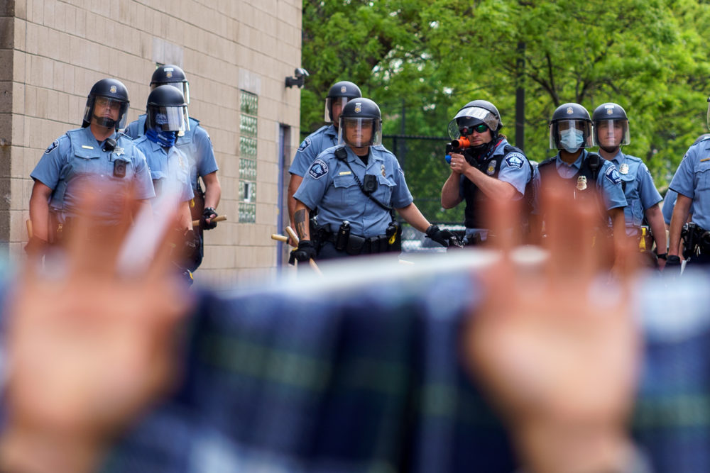 Protesters are trapped between police and other protesters who gathered in a call for justice for George Floyd following his death in Minneapolis, Minnesota. (Kerem Yucel/AFP/Getty Images)