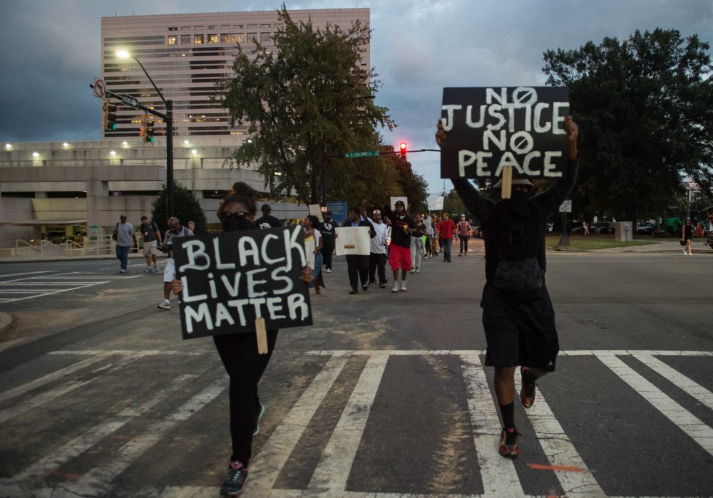 Protesters march during a demonstration against police brutality in Charlotte, North Carolina, on September 21, 2016, following the shooting of Keith Lamont Scott the previous day. (Nicholas Kamm/AFP via Getty Images)