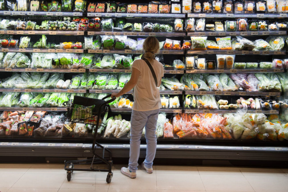 A shopper looks at a shelf of vegetables. (Romeo Gacad/AFP/Getty Images)