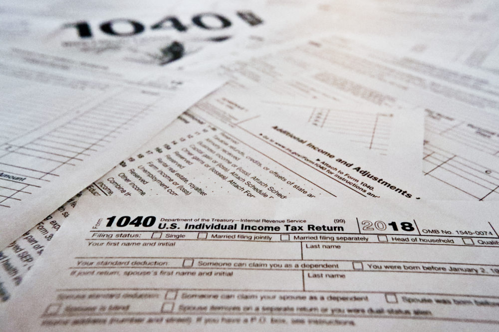 This photo made on Feb. 13, 2019, in Zelienople, Pa., shows multiple forms printed from the Internal Revenue Service web page that are used for 2018 U.S. federal tax returns. (Keith Srakocic/AP)