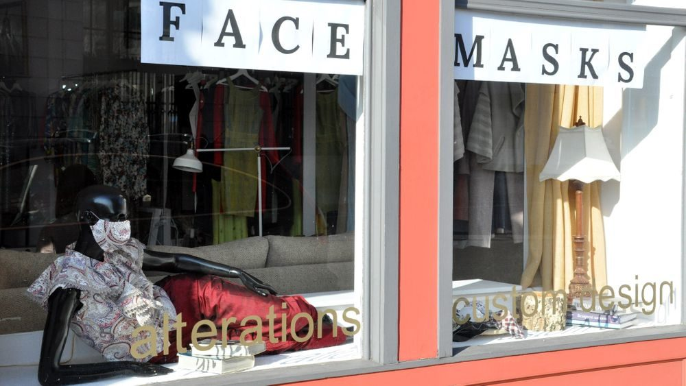 An alteration shop advertising face masks for sale in downtown Westerly, R.I., is pictured here. (Alex Nunes/The Public's Radio)