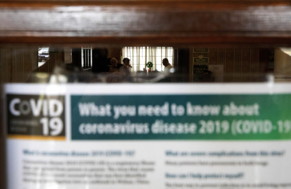 An information sheet on the new coronavirus is posted in the lobby of the South Shore Rehabilitation and Skilled Care Center on March 6 in Rockland, Mass. (David Goldman/AP)