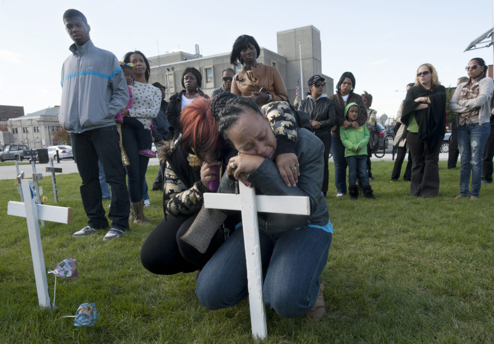 On Oct. 16, 2012, Lisa Anderson wept after a cross in memory of her son, Lateaf Anderson, was placed in a field commemorating that year's homicide victims in Camden in front of City Hall.  (Photo by April Saul)