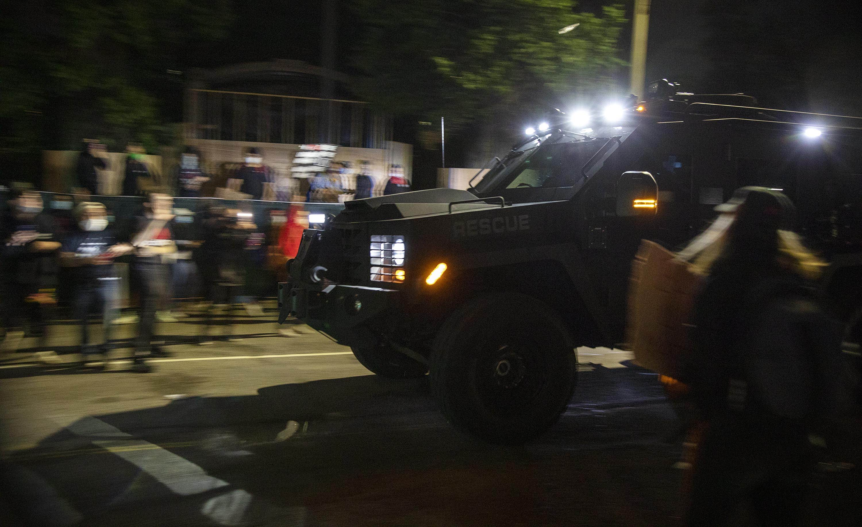 An armored police vehicle drove past the State House as protesters dispersed on May 31. (Robin Lubbock/WBUR)