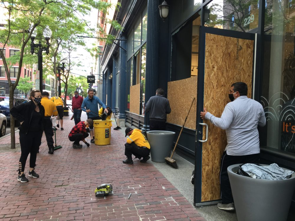 Providence city workers and citizens cleaned up businesses on Westminster Street Tuesday morning. (Sofia Rudin/The Public's Radio)
