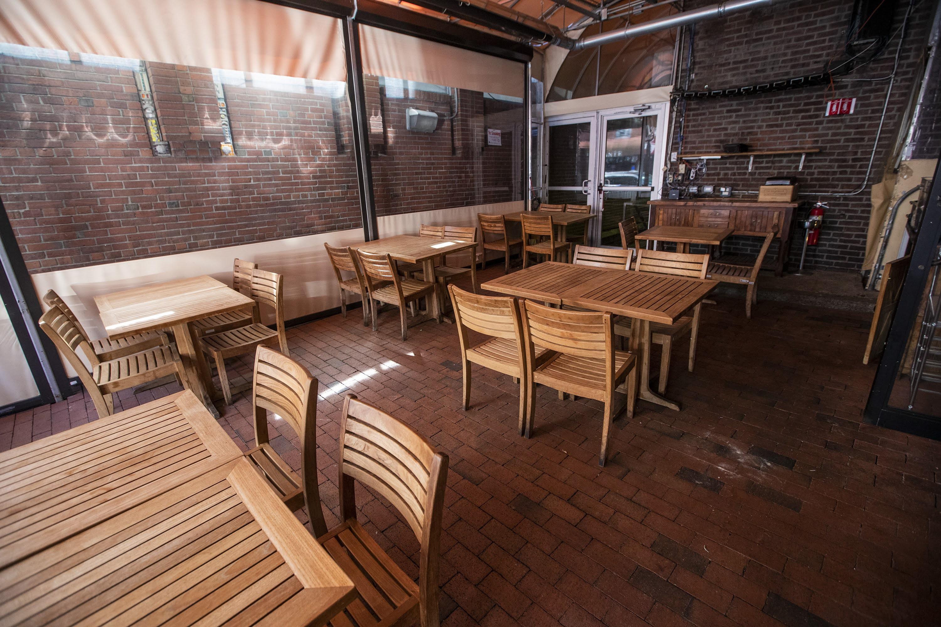 Tables on the Trattoria il Panino patio are spaced 6 feet apart. (Jesse Costa/WBUR)