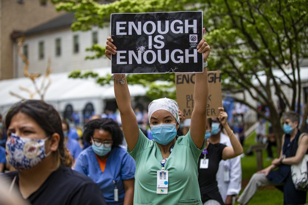 Hundreds of staff at the Massachusetts General Hospital participated in a kneel-in acknowledging the injustice of systemic and individual racism in America at the Bulfinch Lawn outside of the Wang Entrance of the hospital, June 5, 2020. (Jesse Costa/WBUR)