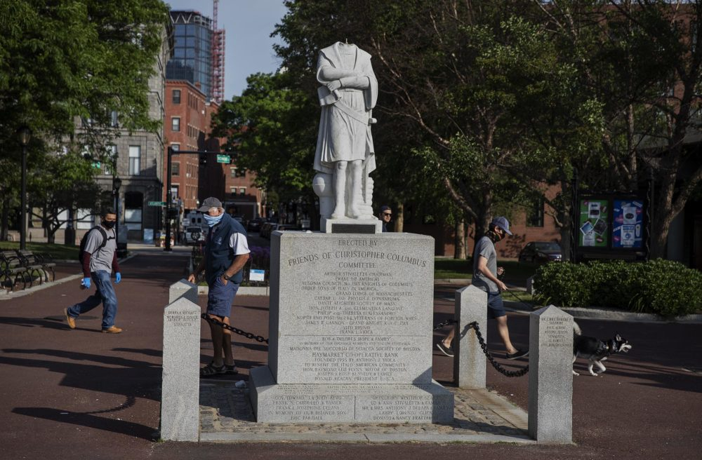 The now headless statue of Christopher Columbus in Columbus Waterfront Park in Boston. (Robin Lubbock/WBUR)
