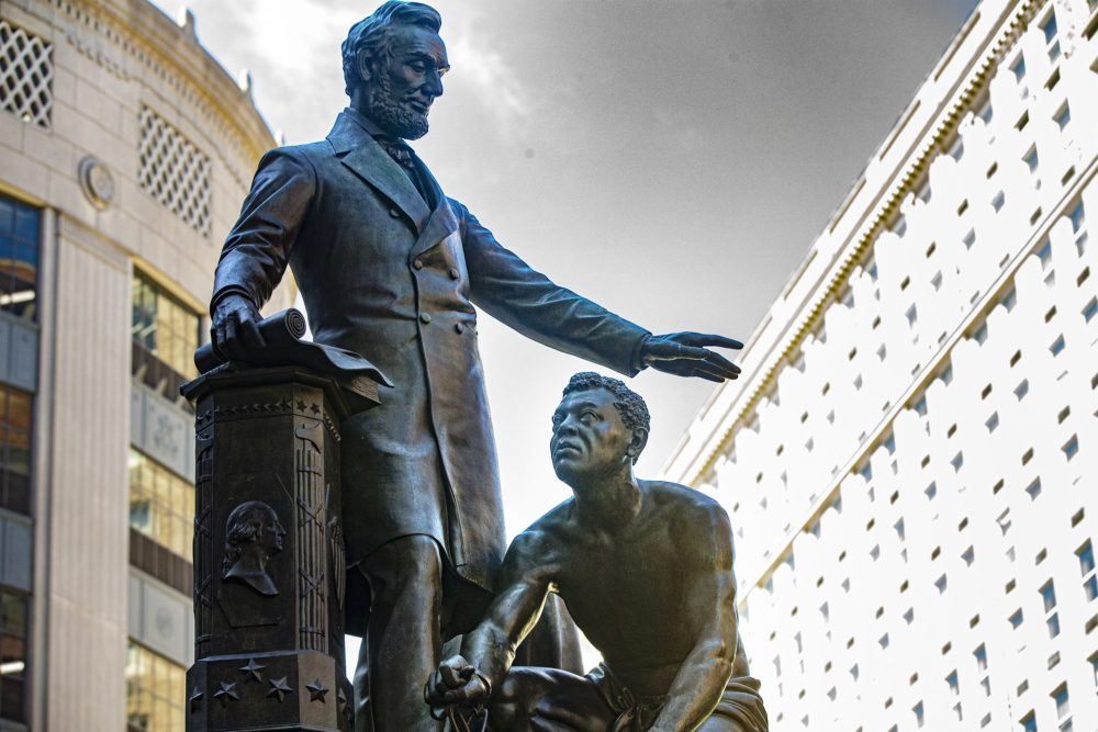 The statue in the city's Park Square is a replica of the Emancipation Memorial in Washington and depicts Lincoln with one hand raised above a kneeling man with broken shackles on his wrists. (Jesse Costa/WBUR)