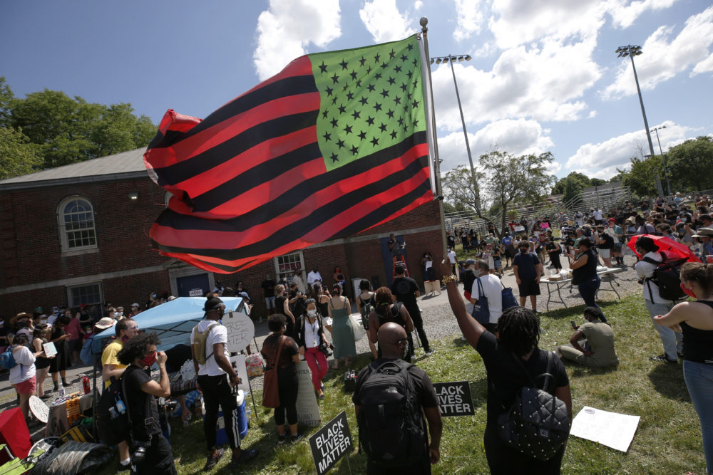 A stylized American Black Lives Matter flag flies during a Juneteenth rally in Boston. (Michael Dwyer/AP)