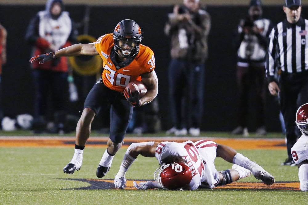 Oklahoma State running back Chuba Hubbard spoke out this week after an image of team head coach Mike Gundy wearing an OAN T-shirt surfaced online. (Sue Ogrocki/AP)