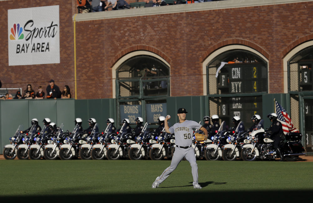 Can the sports community distance itself from its longtime partner: law enforcement? (Jeff Chiu/AP)