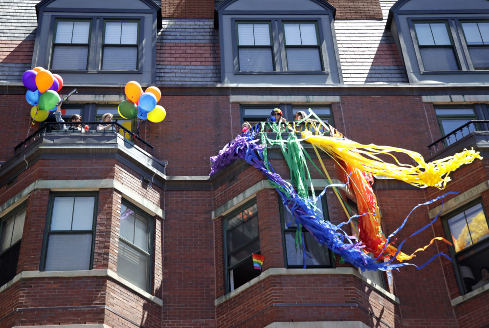 Spectators watch from balconies along the route of the Gay Pride Parade, Saturday, June 8, 2019, in Boston. (Elise Amendola/AP)