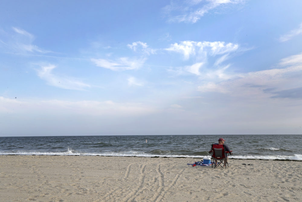 The view at Covell Beach in Centerville, Mass. Vineyard Winds' proposed buried energy cables would stretch from offshore wind turbines, through the ocean, under the sand and parking lot at Covell Beach. (Elise Amendola/AP)