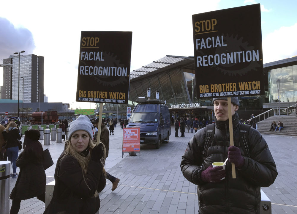 Activists demonstrate in front of a mobile police facial recognition facility in London on Feb. 11, 2020. (Kelvin Chan/AP)