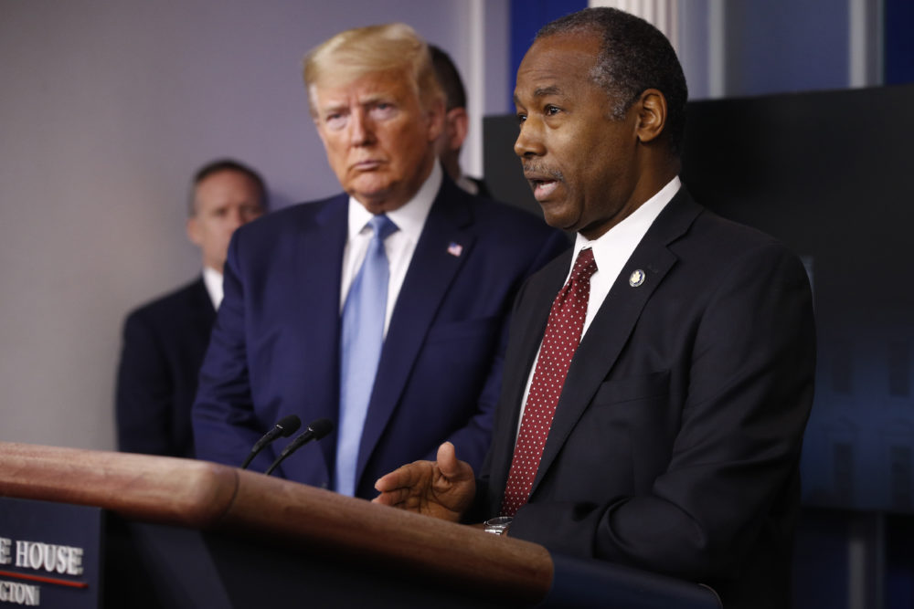 President Trump listens as Housing and Urban Development Secretary Ben Carson speak during a coronavirus task force briefing in March. (Patrick Semansky/AP)