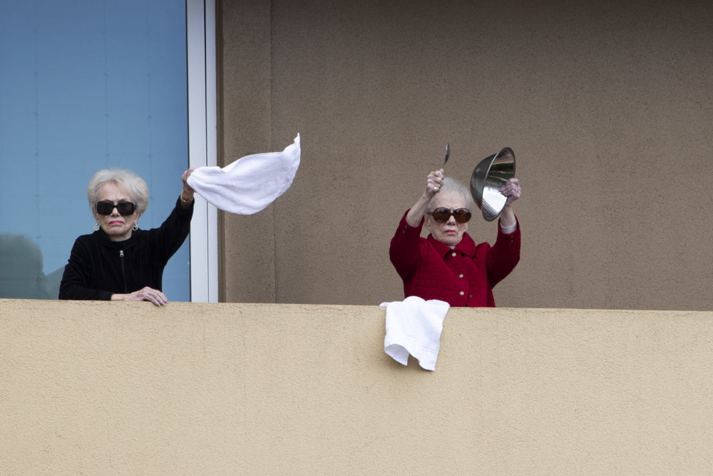 Residents of Vi at La Jolla retirement complex dance and make noise from their balconies, Wednesday, April 8, 2020, in San Diego. (Gregory Bull/AP)