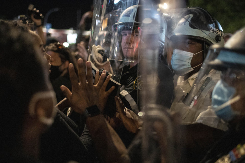 Police hold off protesters during a solidarity rally for George Floyd, Sunday, May 31, 2020, in Brooklyn, New York. (Wong Maye-E/AP)