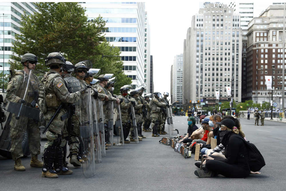 Protesters rally in front of Pennsylvania National Guard soldiers, Monday, June 1, 2020, in Philadelphia, over the death of George Floyd, a black man who was in police custody in Minneapolis. (Matt Slocum/AP Photo)
