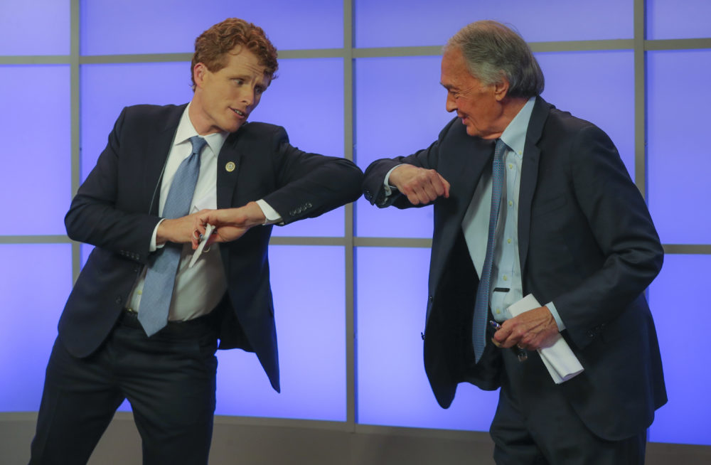 Rep. Joe Kennedy III, left, elbow-bumps Sen. Edward Markey after their debate for the Democratic primary for senator from Massachusetts, June 1, 2020, in Springfield, Mass. (Matthew J. Lee/The Boston Globe via AP, Pool)
