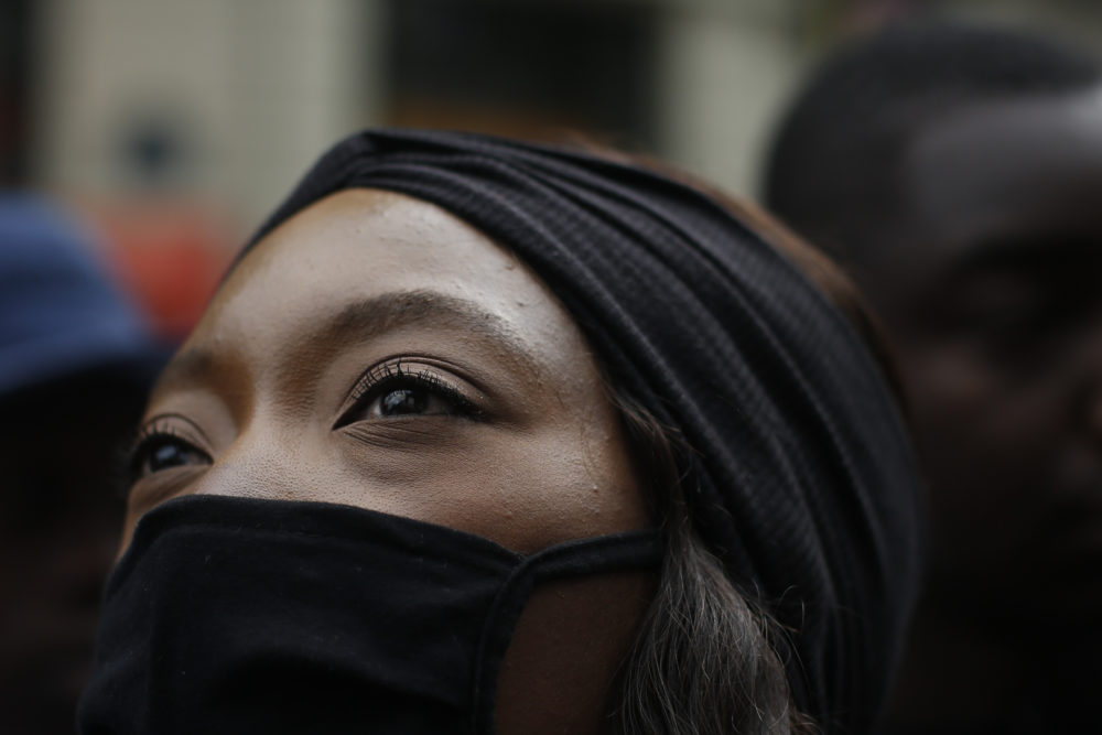 A woman demonstrates against police brutality and racism in Paris, France, Saturday, June 13, 2020, a march organized by supporters of Adama Traore, who died in police custody in 2016 in circumstances that remain unclear despite four years of back-and-forth autopsies. (Thibault Camus/AP)