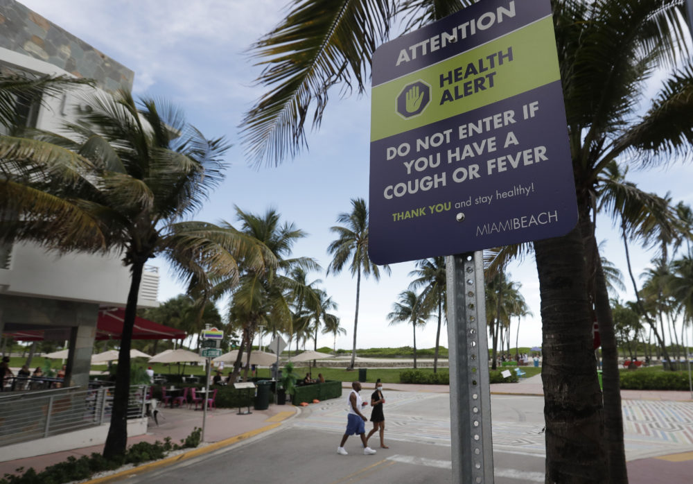 A sign asks people not to visit Miami Beach if they have a cough or fever, Monday, June 22, 2020. (Wilfredo Lee/AP)