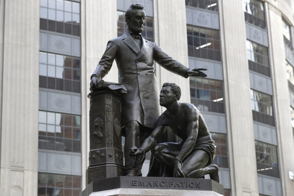 A statue that depicts a freed enslaved man kneeling at Abraham Lincoln's feet rests on a pedestal, Thursday, June 25, 2020, in Boston. The statue in Boston is a copy of the Emancipation Memorial, also known as the Emancipation Group and the Freedman's Memorial, that was erected in Lincoln Park, in Washington, D.C., in 1876. Three years later, the copy was installed in Boston. Calls are mounting for the removal of both statues. (Steven Senne/AP)