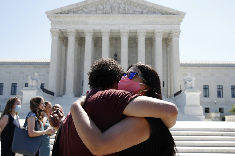 Anti-abortion protesters hug goodbye outside the Supreme Court on Capitol Hill in Washington, Monday, June 29, 2020. (Patrick Semansky/AP)