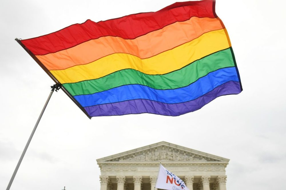 LGBTQ rights demonstrators rally outside the U.S. Supreme Court on October 8, 2019. (Saul Loeb/AFP/Getty Images)