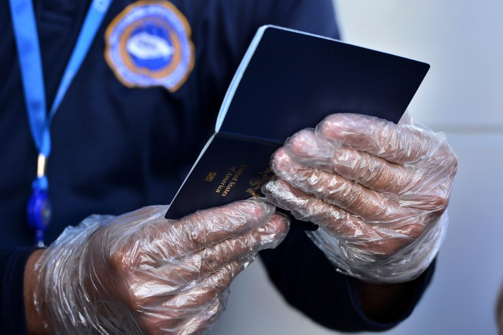 Some countries are considering issuing something called an immunity passport — a document certifying that the person recovered from COVID-19 and now has immunity. (Orlando Sierra/AFP/Getty Images)