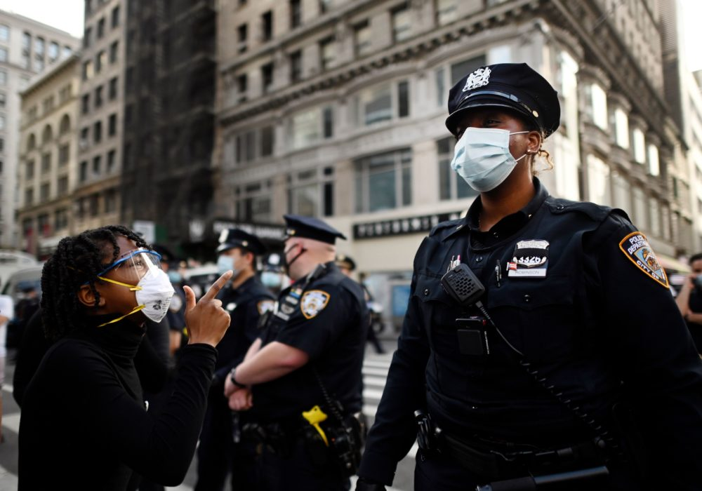 Protesters shout in front of NYPD officers during a demonstration on May 28, 2020 in New York City. (Johannes Eisele/AFP/Getty Images)