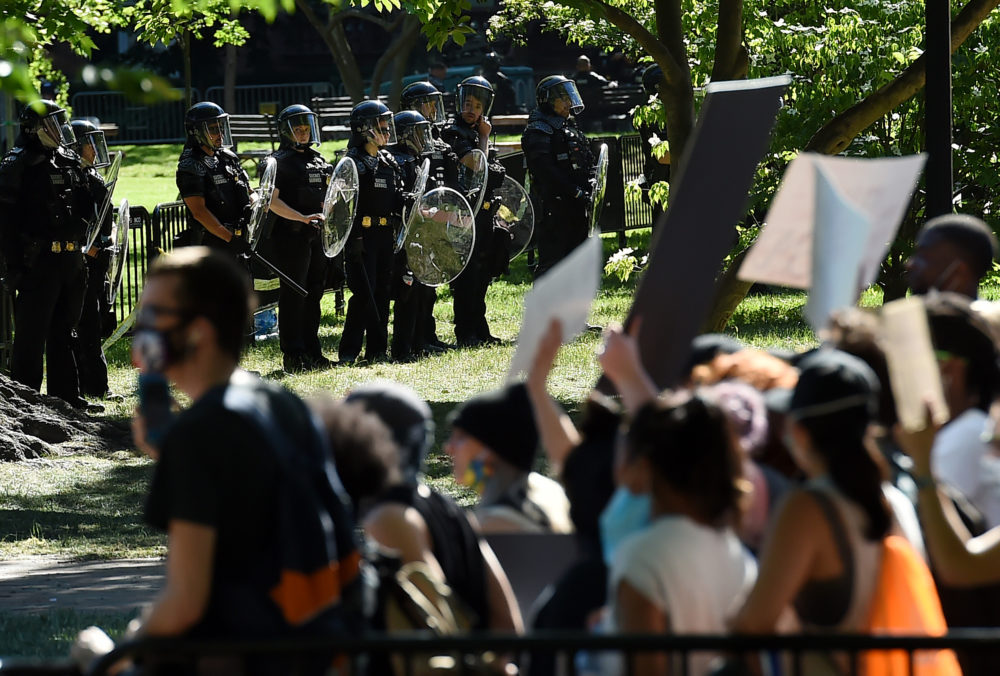 U.S. Park Police stand watch inside Lafayette Square near the White House in Washington, DC on June 1, 2020 as demonstrators protest the death of George Floyd. Police fired tear gas outside the White House as anti-racism protesters again took to the streets to voice fury at police brutality. (OLIVIER DOULIERY/AFP via Getty Images)