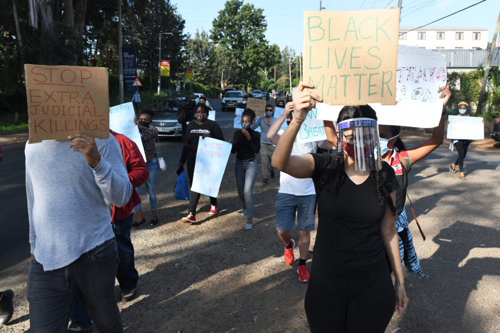 Protesters march during a demonstration in solidarity with the global Black Lives Matter movement as they protest over police brutality and white supremacy in the United States (US), Kenya and globally, outside the US Embassy in Nairobi on June 2, 2020. (Simon Maina/AFP via Getty Images)