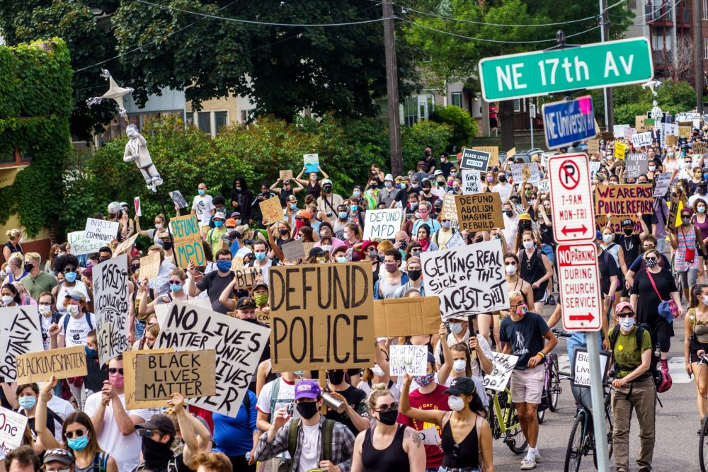 Demonstrators march against racism and police brutality and to defund the Minneapolis Police Department on June 6, 2020 in Minneapolis. (Kerem Yucel/AFP/Getty Images)