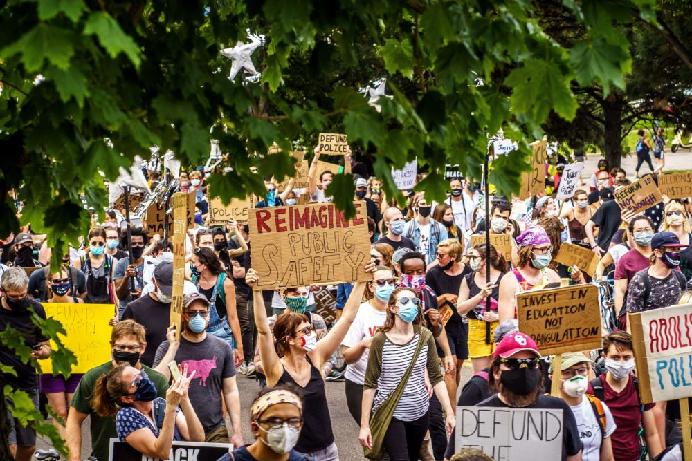 Demonstrators march against racism and police brutality and to defund the Minneapolis Police Department on June 6, 2020 in Minneapolis, Minnesota. (KEREM YUCEL/AFP via Getty Images)