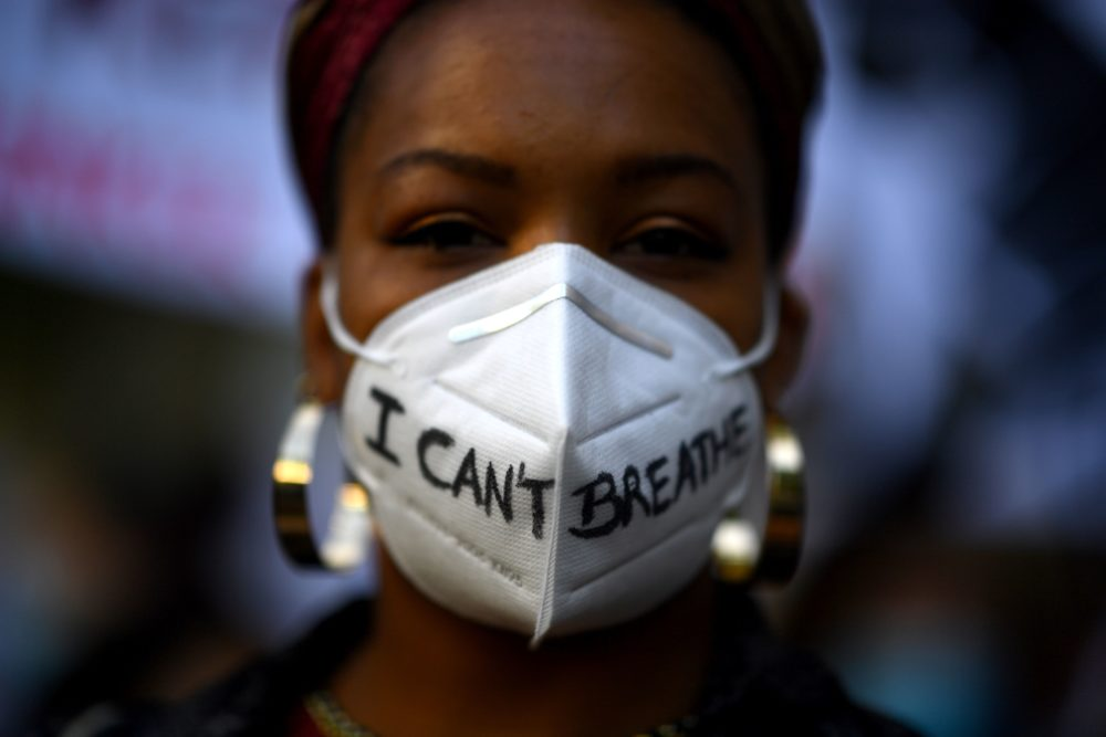 "A woman wears a mask reading ""I can't breathe"" in Madrid, on June 7, 2020, during a demonstration against racism and in solidarity with the Black Lives Matter movement, in the wake of the killing of George Floyd. (GABRIEL BOUYS/AFP via Getty Images)"
