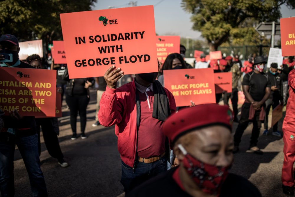 Economic Freedom Fighters gathered in front of the U.S. Embassy in Pretoria, South Africa, in solidarity with the global Black Lives Matter movement on June 8, 2020. (Marco Longari/AFP via Getty Images)