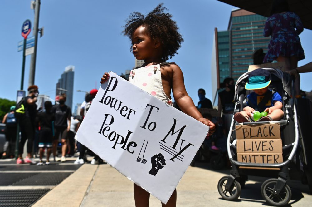 Families participate in a children's march in solidarity with the Black Lives Matter movement and national protests against police brutality on June 9, 2020 in the Brooklyn Borough of New York City. (Angela Weiss/ AFP/Getty Images)