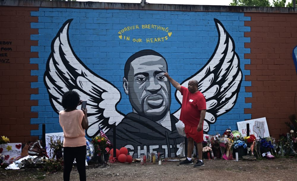 People visit a makeshift memorial for George Floyd placed in his former neighborhood, the Third Ward, in Houston, Texas. (Johannes Eisele EISELE/AFP via Getty Images)
