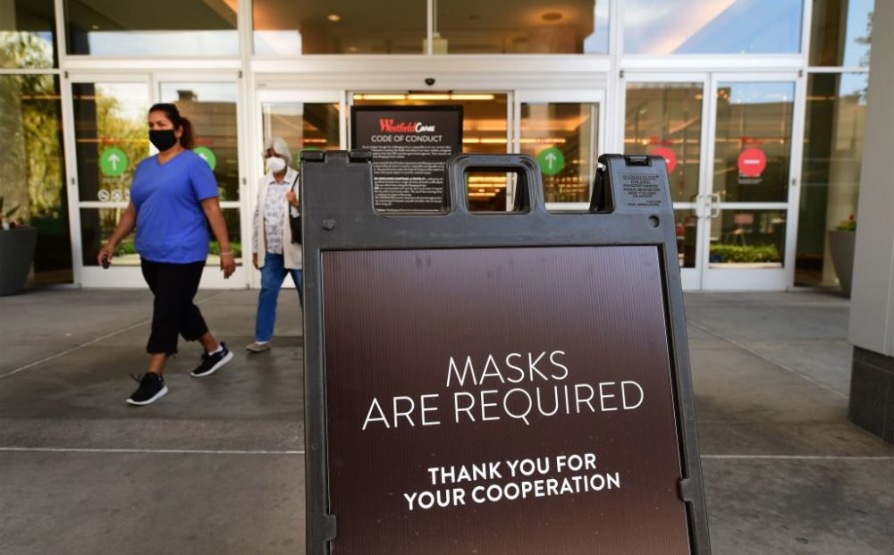 A sign at a shopping mall in Santa Anita, California, reminds people of the mask requirement.(Frederic J. Brown/AFP/Getty Images)