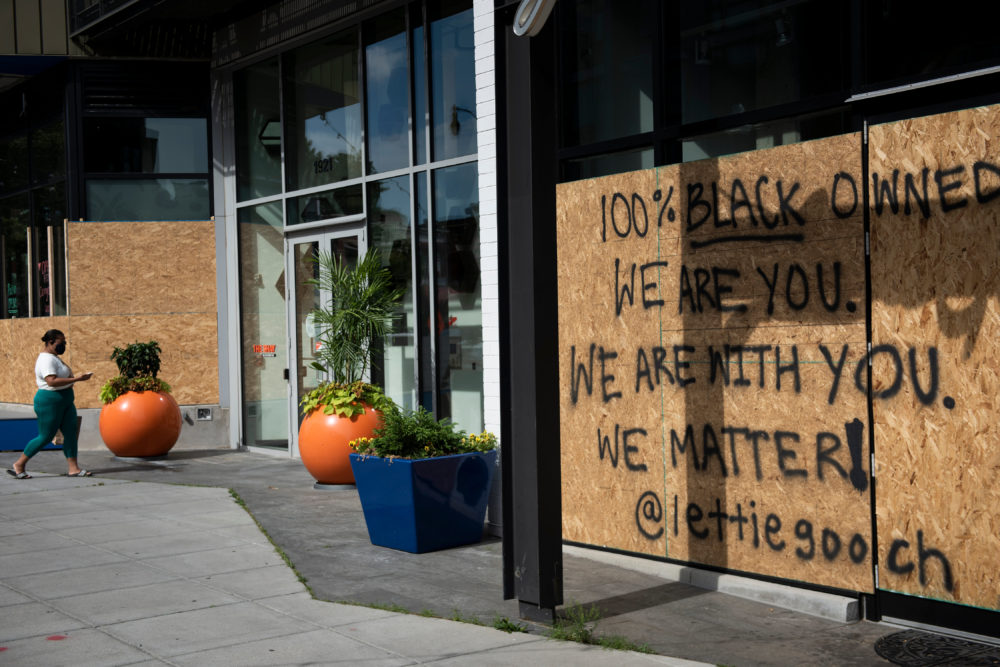 The store front of Lettie Gooch, one of the many black-owned businesses near U Street, is seen boarded up on June 15, 2020, in Washington, D.C. (Brendan Smialowski/AFP/Getty Images)