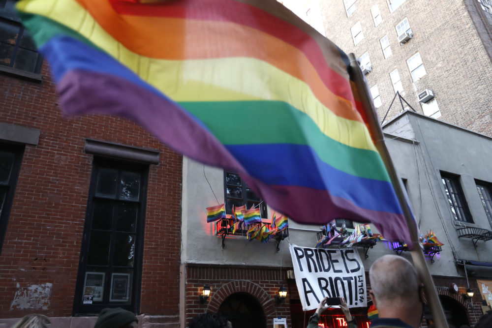 People gather at the historic Stonewall Inn to celebrate the LGBTQ victory, in Greenwich Village, a section of New York City, US on June 15, 2020. (John Lamparski/ NurPhoto via Getty Images)